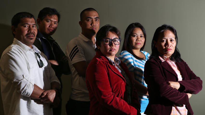Eleven Filipino bakery workers who have sued L'Amande French Bakery alleging labor exploitation include, from left, Fernan Belidhon, Elmer Genito, Romar Cunanan, Louise Luis, Gina Pablo and Ermita Alabado. (Irfan Khan / Los Angeles Times)